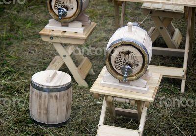 Wooden oak barrel wine, beer with metal crane.