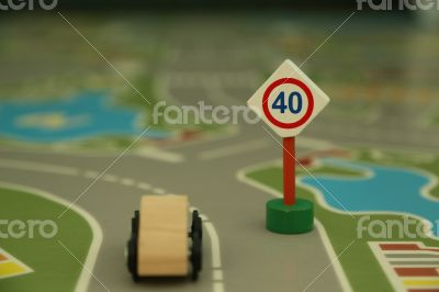 mini wooden road sign `speed limit 40`