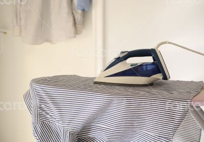 The shirt and the iron on the ironing board