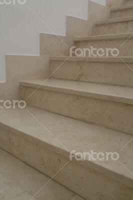Beige marble indoor stairs