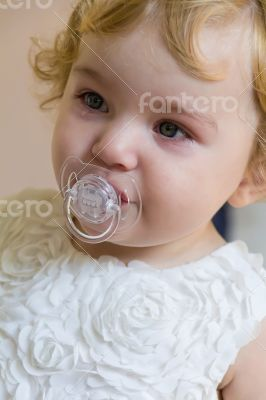Cute infant with tear