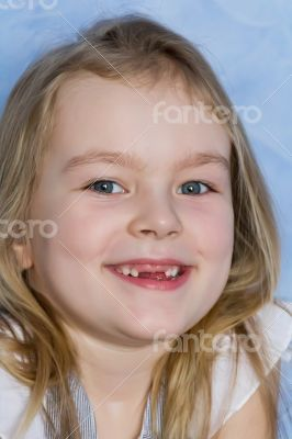 Smiling toothless girl with blond hair