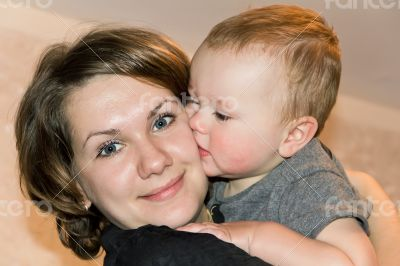 Kissing son with mother