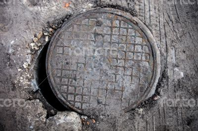 Open manhole with metal cover