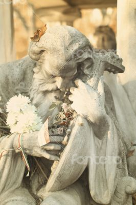 Beautiful Grave with an Old Man Statue in a Hungarian Cemetery