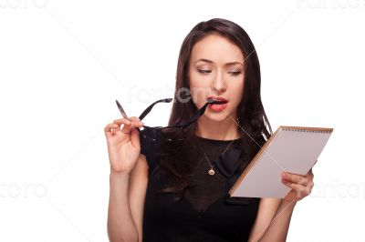 Sexy woman in glasses with notepad