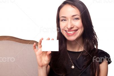 Smiling young woman holding blank businesscard