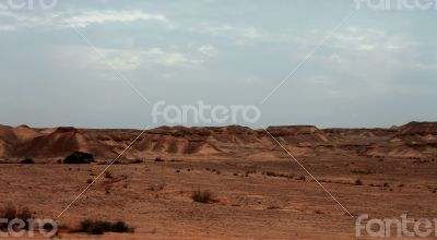 An Egyptian Desert And Mysty Sky in the daylight