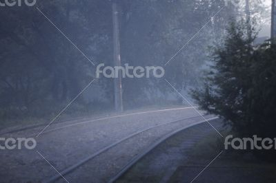 A Twisted railroad in the foggy evening