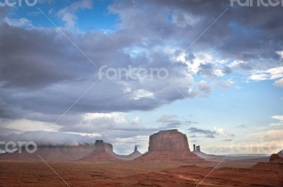 big cloud on mesa in Monument valley