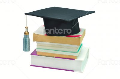 Graduation cap on top of a stack of books