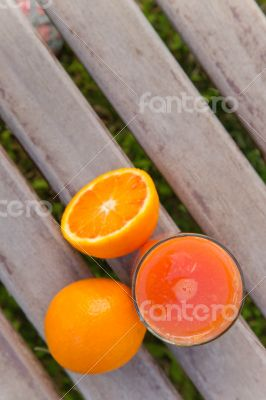 Oranges and a glass of fresh orange juice