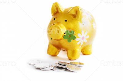 Golden piggibank with coins