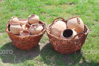 Ancient clay pots in basket