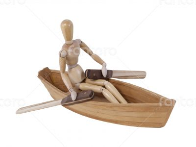 Person Rowing in a Wooden Boat