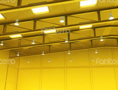 Interior of a empty yellow color warehouse construction