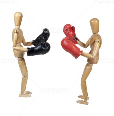 Two People Sparring with Boxing Gloves