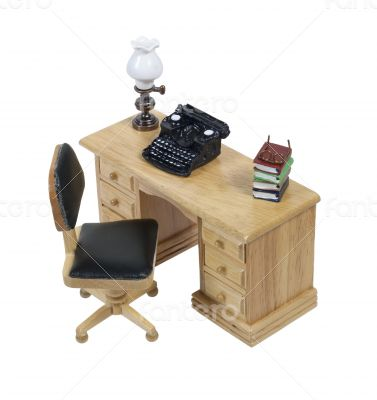 Typewriter with lamp and books on desk