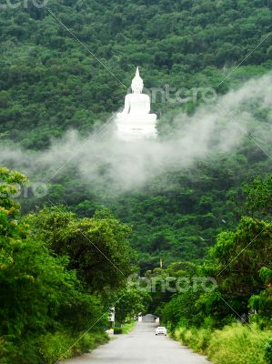 The road to white Buddha Image on the mountain