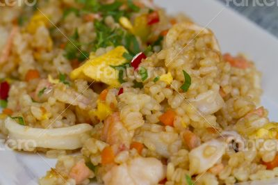 Risotto, tasty dish of boiled rice and seafood.