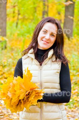 Brunette with bouquet from sheets