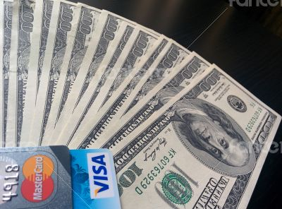 Credit cards and hundred dollar bills