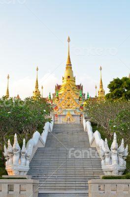Stairs to golden pagoda Phra Mahathat Chedi Phakdi Prakat