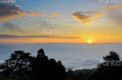 Colorful sunrise above the clouds