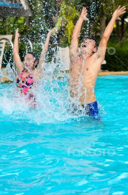 Father and daughter have fun in the pool