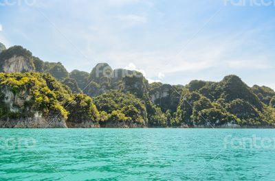 High mountain range above the green lake