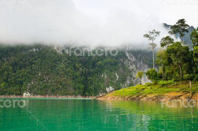Beautiful high mountains and green lake