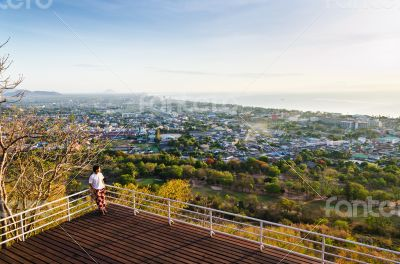 Traveler on view point Hua Hin city at sunrise