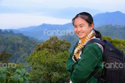 Tourist girl on the mountain
