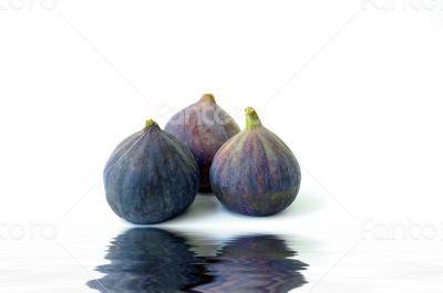 Fresh figs on white background
