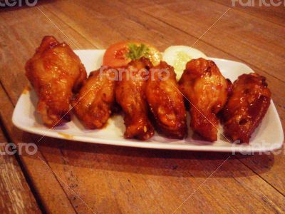 Grilled chicken wings and chicken leg