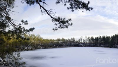 Panorama of an abandoned stone pit in winter