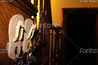 Flip flop key hanger on stairs