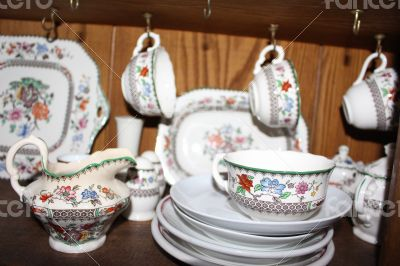 China Plates Cup Jug Tea Dishes on Wood Background