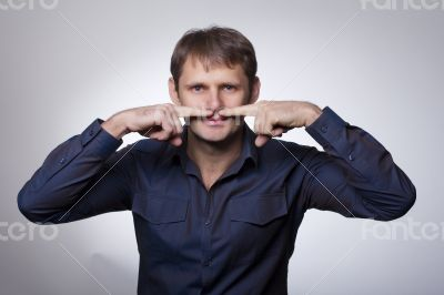 Handsome man showing moustache