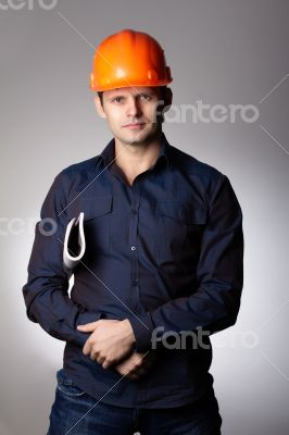 Builder in protective helmet.