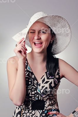 Beautiful smiling girl in a hat