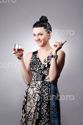 Beautiful smiling girl holding a glass.