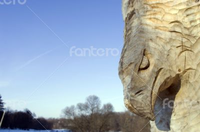 isolated totem wood pole in the blue cloudy background
