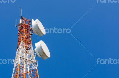 Telecommunication tower on blue sky background