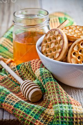 fresh cookies in a bowl, tablecloth and honey