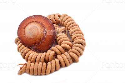 Shell with wood beads on the white background