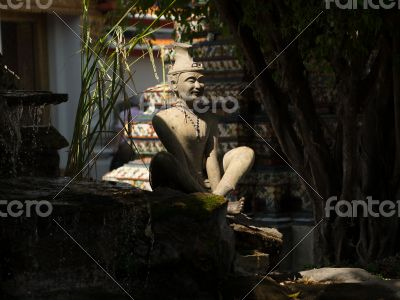 Thai yoga pose hermits beside water fall