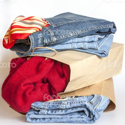 Shopping: jumper and jeans in paper packages