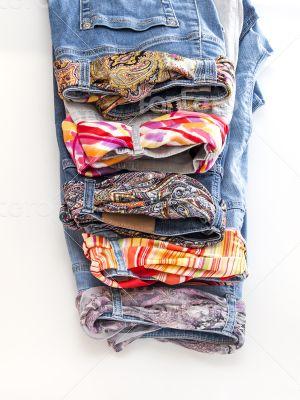 Women\'s jeans with motley silk belts