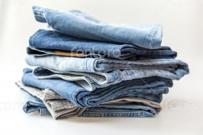Jeans of indigo color on a show-window of shop